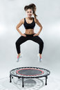 Cute Fitness-girl Play With Rebounder Royalty Free Stock Photography - 67234497