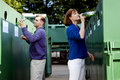 A Mid-adult Couple Recycling Glass Bottles Royalty Free Stock Image - 67253546
