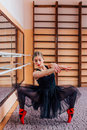 Ballerina Wearing Black Tutu Doing Exercise In Training  Hall. Stock Photography - 67254632