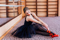 Ballerina Wearing Black Tutu Doing Exercise In Training  Hall. Royalty Free Stock Image - 67255466
