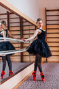 Ballerina Wearing Black Tutu Doing Exercise In Training  Hall. Royalty Free Stock Photos - 67255738