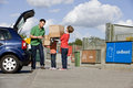 A Father And Children Recycling Cardboard Boxes Royalty Free Stock Photo - 67256305