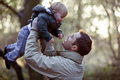 A Father Lifting His Son In The Air Royalty Free Stock Photos - 67257268
