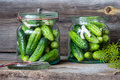 Jars Of Pickled Marinated Cucumbers On Rustic Table Royalty Free Stock Photo - 67261875