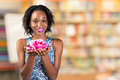 African Woman Holding Rose Blossom Stock Photos - 67273433