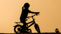 Young Girl Riding In The Afternoon Sun Stock Photography - 67320382