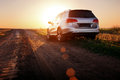 Grey Car Stay On Dirt Road At Sunset Royalty Free Stock Photo - 67345135