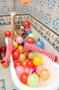 Blonde Woman With Sunglasses Playing In Her Bath Tube With Bright Colored Balloons. Sensual Girl With White Red Striped Stockings Royalty Free Stock Images - 67370119