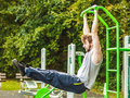Active Man Exercising On Ladder Outdoor. Royalty Free Stock Photography - 67379917