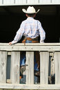 Cowboy Sitting On Wooden Fence Stock Photography - 6741332