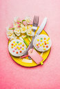 Top View Of Festive Table Place Setting With Cake, Narcissus Flowers, Cutlery  And Blank Tag  On Pastel Pink Background, Top View Stock Photos - 67400293