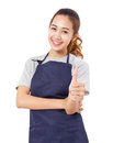 Asian Woman Wearing Apron Showing Thumbs Up. Stock Photos - 67404173