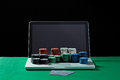 Casino Chips And Cards On Keyboard Notebook At Green Table. Royalty Free Stock Photo - 67409365