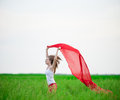 Young Lady Runing With Tissue In Green Field. Woman With Scarf. Stock Photography - 67410202