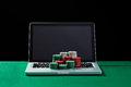 Casino Chips On Keyboard Notebook At Green Table. Stock Photo - 67434790
