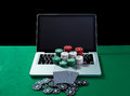 Casino Chips And Cards On Keyboard Notebook At Green Table. Royalty Free Stock Photo - 67434815