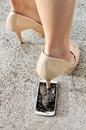 High Heel Shoe Crushing A Smart Phone. Royalty Free Stock Photo - 67455305
