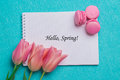 Tag Hello Spring With Three Pink Tulips And Three Pink Macaroons Stock Photography - 67457052