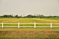 White Fence In Farm Field Stock Images - 67463514
