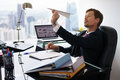 Bored White Collar Worker Throwing Paper Airplane In Office Stock Photo - 67486050