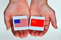 Two Hands Holds The National Flags Of The United States Of Ameri Royalty Free Stock Photo - 67505205
