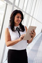 Hispanic Businesswoman Using Digital Tablet In Modern Office Stock Photography - 67523622