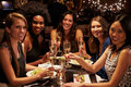 Group Of Female Friends Enjoying Meal In Restaurant Stock Photography - 67526022