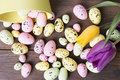Colorful Easter Eggs On Bowl And Tulips Stock Photography - 67558992