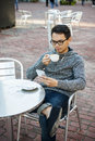 Young Asian Man In Outdoor Cafe Royalty Free Stock Photos - 67564918
