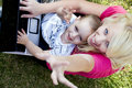 Mother And Child Working Together On Laptop Royalty Free Stock Images - 6765519