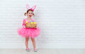 Happy Child Girl In A Costume Easter Bunny Rabbit With Basket Of Stock Photos - 67610253