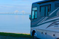 RV At Beach With Tampa Bay Sunshine Skyway Bridge Royalty Free Stock Photography - 67624197