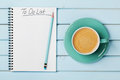 Coffee Cup And Notebook With To Do List On Blue Rustic Desk From Above, Planning And Design Concept Royalty Free Stock Photo - 67628915