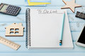 Notebook With To Do List And Different Office Tools On Blue Rustic Desk Stock Photo - 67629110
