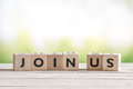Join Us Sign On Wooden Cubes Stock Image - 67629211