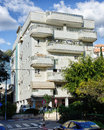 White 5-story Residential Building With Fallen Down Tiles Royalty Free Stock Photo - 67635245
