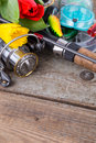 Fishing Tackles With Spring Flowers Stock Photos - 67644233