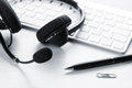 Office Desk With Headset And Keyboard Royalty Free Stock Photo - 67655335