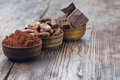 Dark Chocolate Pieces, Cocoa Powder And Cocoa Beans Royalty Free Stock Photos - 67663238