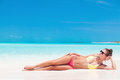 Young Girl In Bright Bikini Tanning At Tropical Beach Royalty Free Stock Image - 67668686