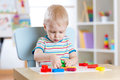 Little Boy Learning To Use Colorful Play Dough In Nursery Room Royalty Free Stock Photo - 67675925