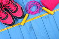 Pair Of Pink Sport Shoes And Accessories For Fitness On Blue Boards Background, Copy Space For Text Stock Image - 67680031