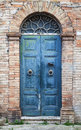 Blue Wooden Door With Arch In Old Brick Wall Stock Photos - 67697993