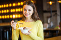 Young Beautiful Girl Eating Ice Cream In Cafe Royalty Free Stock Photography - 67698497