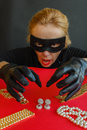 A Woman Thief Is Going To Steal The Jewels Stock Photos - 67748393