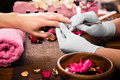 Closeup Finger Nail Care By Manicure Specialist In Beauty Salon. Royalty Free Stock Image - 67750046