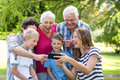 Smiling Family Using Smartphone Royalty Free Stock Image - 67755086