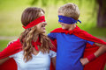 Mother And Son Pretending To Be Superhero Stock Images - 67759324