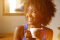 Smiling Young African American Woman With Coffee Cup Stock Image - 67785691