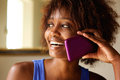 Smiling Young African Woman Talking On Cell Phone Stock Photos - 67785703